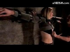 Blonde Hotty Tied To Cross Stomach And A-hole Spanked Bumpers Rubbed In The Dungeon