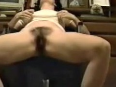 This is a great movie of a woman finger fucking herself at the office. The camera is sitting on the ground looking up at the hotty sitting in a chair. You can hear her moaning when that babe makes herself cum.