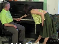 Busty gal in a provoking blouse getting it on with her grey-haired teacher