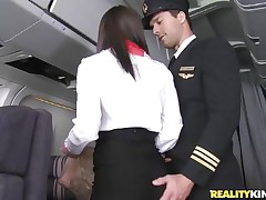 Willing for take-off captain! But previous to that, this curvy flight stewardess went down on her knees to give the pilot a blowjob! Joining the mile-high club has not at any time been this hot, especially when a beautiful brunette cabin crew undresses for the captain to fondle her big ass! Bon voyage passengers!