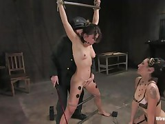 Vai is a hot brown haired milf who enjoys having electrodes all over her body while this chick is tied up with bondage devices. She also has a ball gag in her mouth, because they know this chick is a screamer. She has a large time fun when Princess Donna Dolore takes a vibrator and starts rubbing on that shaved pussy.