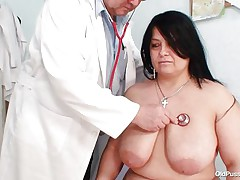 Chubby brunette Rosana went to doctor's to get her body checked up well. But there is this nasty pervert doctor who makes her naked and begins playing with her firm fat body! Watch how he is toying with her massive breasts and gaping her pussy. This guy even fingers it to make her horny so that he can screw her well!