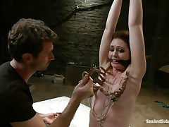 James is sick and tired of her attitude and decides to dominate her. After adding some more clothespins on her thin white body he sticks his rod between her wet lips and the way she's sucking it makes him ease her torment and removes a not many pliers, will this babe be a worthy gal from now on?