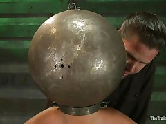 Adrianna Luna has her legs held apart by a support and her hands are encased by metal balls. Her head is encased by a metal ball as well and pumps on her nipples. This babe acquires a sex tool on her cunt and acquires the okay to cum. Then she's tied to a table and having clamps put on her cunt and tits. Freaky!