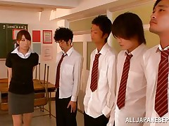Arisu desires discipline and that babe aligns her students in order and then kneels to suck every and every one. The boys broke the line and surrounded her so now that babe has all those hard dongs around her pretty face. Can that babe handle all those cocks and will they repay their teacher with a few loads of cum on her face?