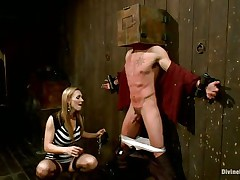 Blonde milf Tanya enjoys being Casey`s mistress and plays hard with his balls. This guy has his hands tied up to the wall with a box on his head. This babe can't live without torturing his nipps and making him feel like the thrall this chab is. Casey was a bad chap and now this chab must receive the right punishment! Watch how his balls tremble.