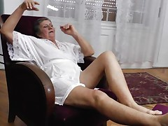 Watch this short haired granny masturbating in her room. She is alone and this playgirl needs to calm the doxy inside her who needs knobs to fuck. So this lady has only one way to survive. That is playing on her own! Watch how this playgirl is groping her own tits and then rubbing her bawdy cleft before doing a nice fingering!