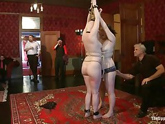 On the Upper Floor, girls all over the place are being punished. There's two bound up face to face getting caned, one more being flogged while holding a stripper pole, one more getting spanked by a man and her face slapped by a woman, one more getting her booty lashed with a whip, and one sucking cock.