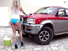 Hawt Michelle Moist is at outdoor washing a car. And this babe is all juicy due to this washing stuff. Well, juicy means this babe is juicy in her c section too. Getting crazy with her temptation this babe is taking off her clothes and showing her small mangos and constricted ass. And that attracts a dick which this babe is engulfing now.