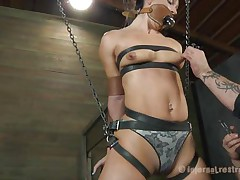 What do we have here? It's a slut, all fastened up in leather belt and hangs there waiting to be punished. She was a very bad girl and her punishment needs to be hard! Wenona has her face hole gagged and the executor rubs her twat with a vibrator. Let's see if this guy has something to stick it in her arse