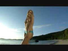 Flawless bikini cutie on a beach gets hot