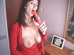 British MILF fucks herself with a couple of high heeled shoes