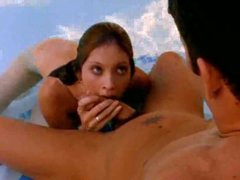 Angel in the pool sucks on a large cock