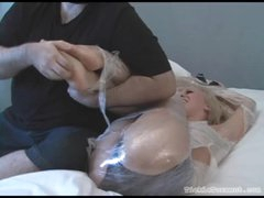 Honey fastened in plastic wrap giggles while tickled