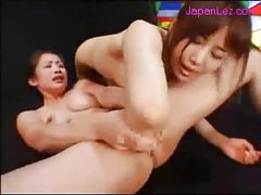 Oriental Beauty Getting Her Cunt Fingered During the time that Fisting Other Beauty Cunt Rubbing In Scissor On The Mattress