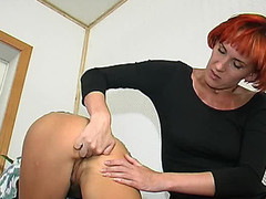 Redhead lesbo honey fingering constricted butt previous to strap-on screwing on floor