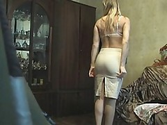 This blonde fem was late so that babe didn't have time to look around or even think that there could be a voyeur with the livecam in her room when that babe put on her white lacy bra and beige petticoat