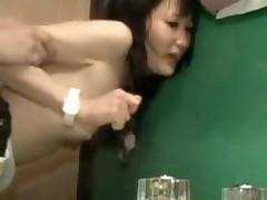 It is a taut fit in this bathroom, and a taut fit in her pussy.  But this couple manages to fuck in several different positions, and finally this chab leaves his hot cum inside her, a fine creampie for us to see.