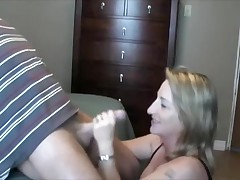 This lady loves to handle and engulf her husband's cock.  This babe sucks it, puts on some flavored lube, and the strokes the shaft whilst this babe tonguing the tip in her mouth.  That guy finally cums in her mouth, moaning, and this babe swallows, with just a little bit of the cum dribbling out.