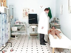 Naked Mature lady with large tits visits the doctor for her pussy examination. That honey is ordered to lay on the patient's couch doctor examines her stomach and then wears his gloves and tells her to spread her legs so that her cunt can be tested. Doctor examines it and then checks her wazoo and ask her if that honey had anal sex ever that honey replied with no.