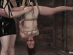 Claire Adams has Trinity Post's vagina wired. She's not merely tied up but upside down, and gagged to boot. She's got a metal plug in her twat and Claire's using a sex toy on her clit, making her crave to cum. That babe gets permission to cum and that babe does several times, moaning loudly through her ball gag.