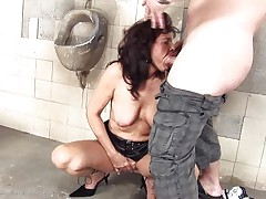 She's a bawdy whore and does everything a man asks her. Here she is, in an abandoned public toilet engulfing this chap and then licking his anus in advance of that guy bonks her from behind. She's a cougar that enjoys a good bawdy fuck and probably will enjoy his semen too so stick with us and watch this wench in full action