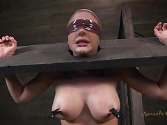 Clamps with weights were attached on her big boobs and duct tape was used to blindfold her. Now she stays there in that servitude device and has a rodeo sex machine under her that's rubbing her shaved pussy. To make things interesting an executor comes and deeply mouth fucks this slut girl, chocking her with pecker