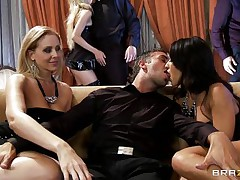 A blond and a darksome brown are rubbing a guy's crotch whilst sitting on a couch. They pull out his cock and start to suck it, every awaiting her turn. Another rod enters the scene and the darksome brown goes to blow it.