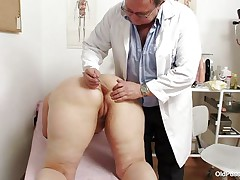 Yvonne is at gynecologist totally naked and waits for the doctor to examine her body. She's a bit bulky but that means there's a lot more to love as the doctor carefully and gently inserts a medical tool in her hot bald dark hole and then this chab gapes her bald vagina looking inside her pink pussy, that cunt is ideal for a hard dick and maybe the doc will give her some fucking therapy.