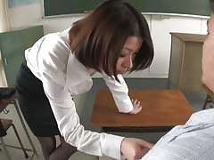 I stayed after hours to have a chat with me teacher Kaoru, damn she's a fine piece of ass and all the boys in the class want to nail her. Luckily Kaoru was insanely slutty that time and this babe knelt in front of me, took out my cock and started to suck it and the balls too. I filmed her and boy I'm proud of that!