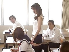Manami Suzuki can't live without teaching. Someone's out to expose her for the floozy that babe really is, hitting the remote control of her vibrator, causing her to groan as that babe walks throughout the class. A student's father comes in, his son saying the teacher's a porn star. Pretty soon she's nude in front of the class.