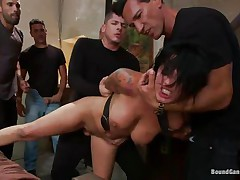 Eva Angelina is a white 27 years old american girl with a nice pair of mangos which has the bad luck to be surrounded by five horny guys who like coarse fucking. They test her face hole size by inserting their dicks so deep until she can't even breathe. Next, they spread her legs and alternative fuck her