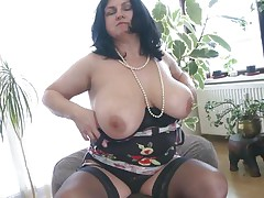 This chubby aged is going avid and definitely in need of some masturbation. So with out wasting any time she is revealing her huge boobs and crushing them to make her pussy wet. After she is rubbing her pussy and fingering it. As soon as is becomes wet she is licking her love juice through her hands.