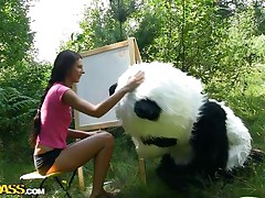 Mr. Panda is outside in the middle of nature and the thin brunette honey that's with him wishes to prove him what an artist this babe is. Well, this babe may not be good at painting but this babe surely knows how to make him cheerful by engulfing his big panda cock. Stay with 'em and have a fun the wilderness of the forest and much more