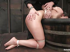 The old, experienced executor is showing this youthful hotty what he is capable of. He tied her hands and legs and grabbed her by the neck so he could put her head below water. That babe is wet and dominated and looks like this slut enjoys her situation a lot, especially when he slaps her ass and uses a sex tool to stimulate her clit.