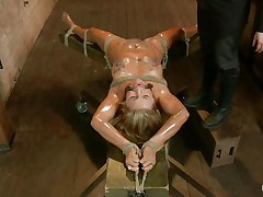 Blonde slut Cameron is all tied up with strings to a wooden table and face hole gagged. With her legs spread, that sweetheart gets fingered and has a sex tool on her clitoris. Let`s take a close look at that sexy oiled up body and with wax all over her! Will her goddess make that wench cum if her cunt gets fisted so hard?