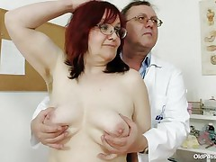 Brunette mature lady is lying on the gynecologist's table and the doctor is examining her pussy. This stud is wearing gloves and fingering her cookie right after that stud examines her nice miniature tits. This stud is inserting a thin medical tool in her tight ass. You really needs to watch where the doctor ends up.