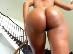 Brazilian in a short dress teases her ass
